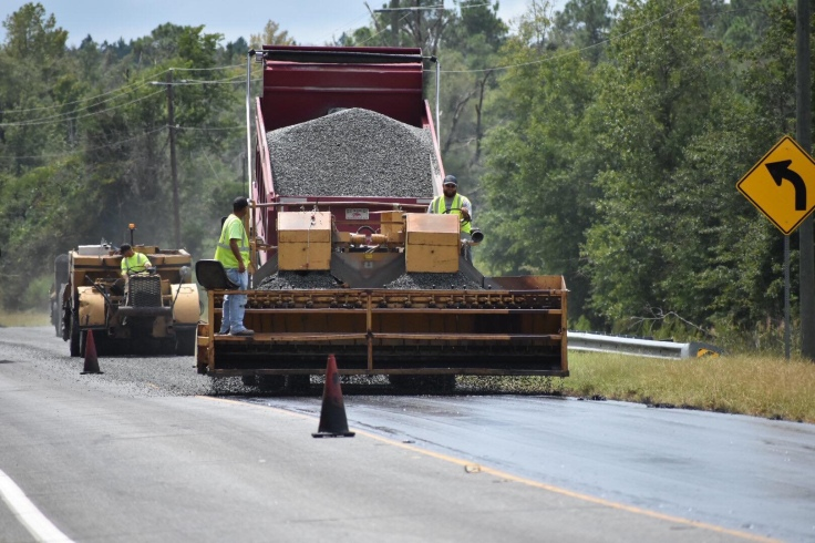 Work crews resurface a roadway. (Georgia DOT photo)