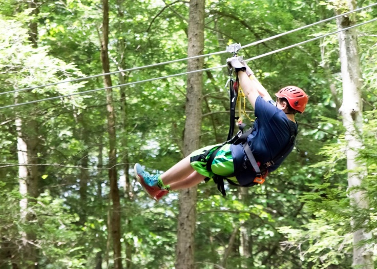 Photo of participant on canopy tour (Summit Bechtel Reserve photo)