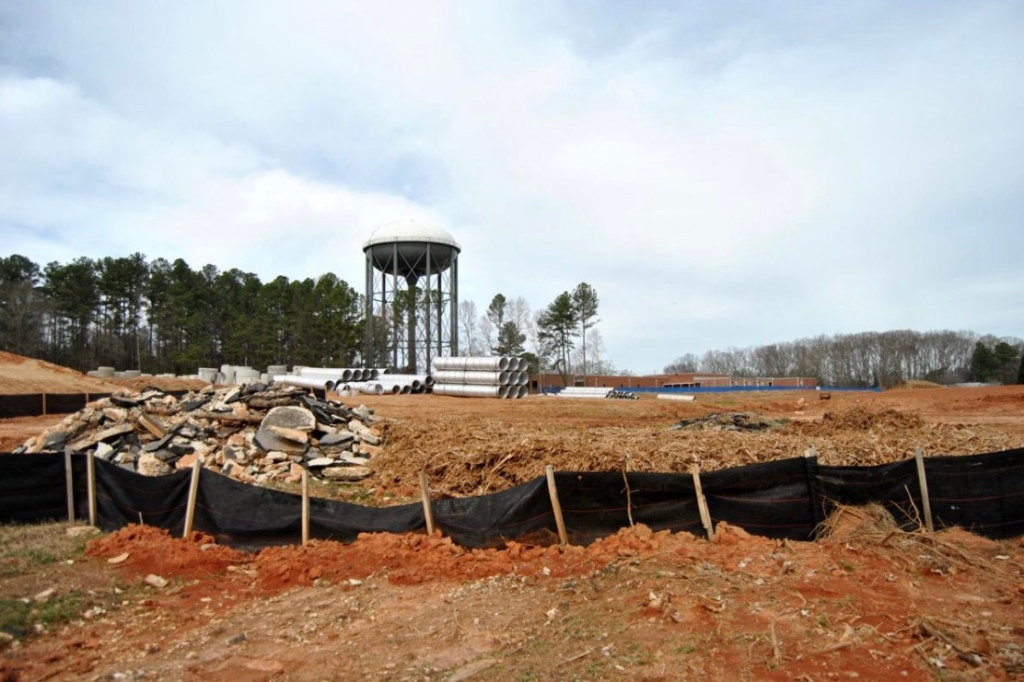 Photo of construction with a water tower in the background (Henry Herald photo /Heather Middleton)