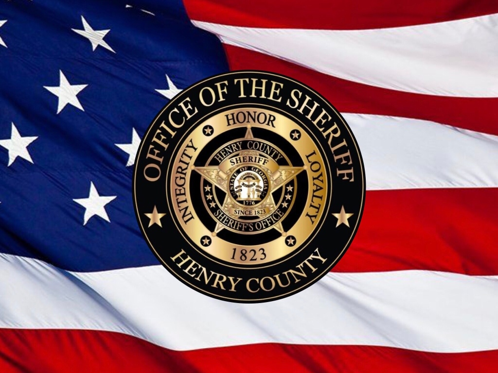 Photo of Henry County Sheriff's Office logo on American flag background (special photo)